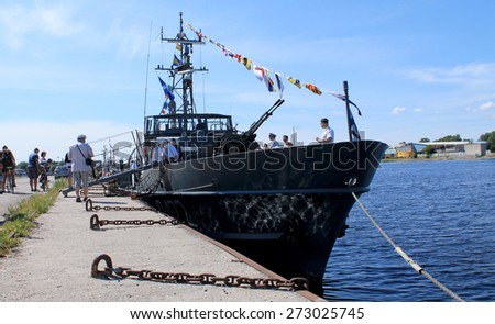 ESTONIA, PARNU / JUNE 28 / 2014 - Military ship at the pier. Every summer, tourists have the opportunity to board the boat and border acquainted with the work of the team.