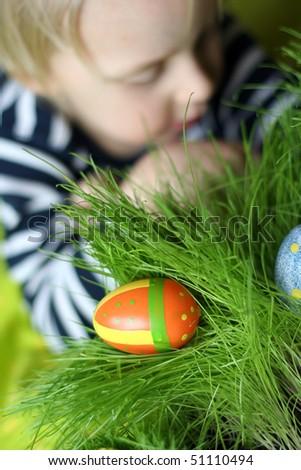 Estrer painted egg on grass - stock photo