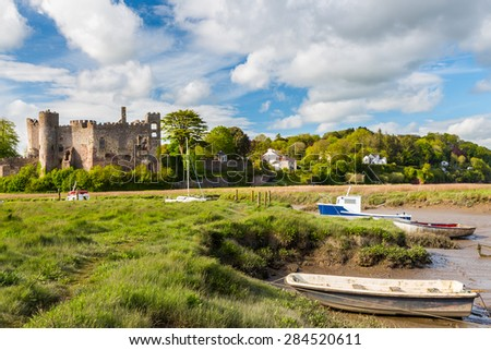 Estuary of the River Taf with Laugharne Castle  in the background Carmarthenshire, Wales UK Europe - stock photo