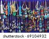 et of colorful traditional vintage necklace on blue back ground - stock photo