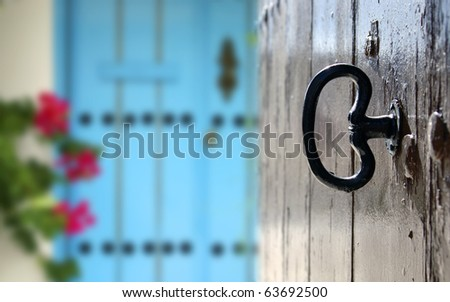 etail of a brown door with his key and back streets of Andalusia - stock photo