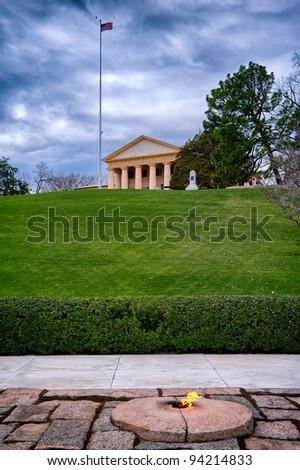Eternal fire by John Kennedy grave and memorial and Arlington House, Arlington National Cemetery, Arlington, Virginia, USA - stock photo