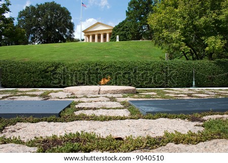 Eternal flame over JFK's grave - stock photo