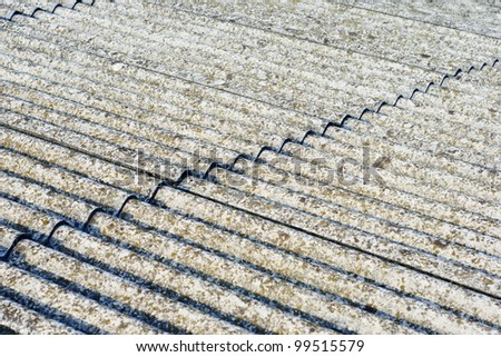 Eternit roof covering of a scruffy old and moldy - stock photo