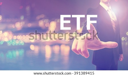 ETF concept with businessman on blurred city background