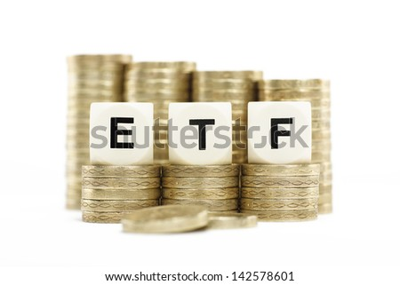 ETF (Exchange Traded Fund) on stacks of gold coins with a white background - stock photo