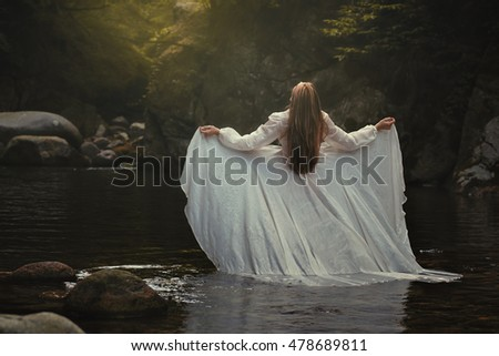 Ethereal woman listening the river music. Surreal and romantic