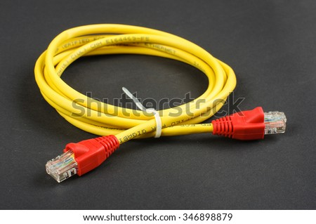 Ethernet cable isolated on the dark background - stock photo