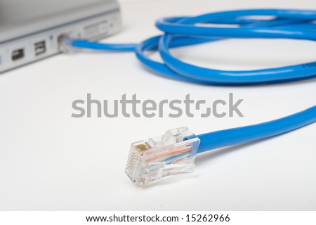 Ethernet cable plugged into a lap top - stock photo