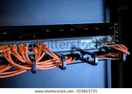 Ethernet cables of internet switch in server room - stock photo