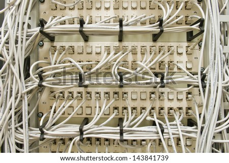 ethernet cables on a patch panel - stock photo