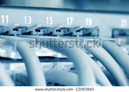 Ethernet Hub with Cat 5 Connectors - stock photo