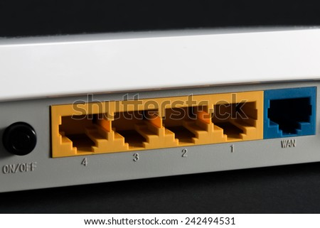 ethernet port on the back of the router, network port on black background - stock photo