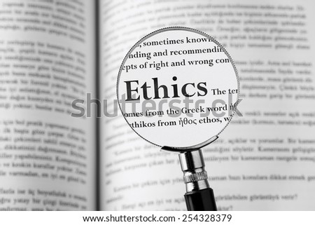 Ethics holding Magnifying Glass . Studio Shot - stock photo