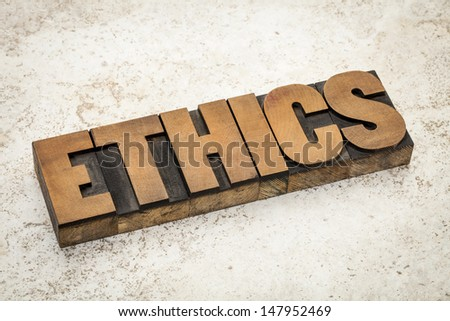 ethics word in vintage letterpress wood type on a ceramic tile background - stock photo
