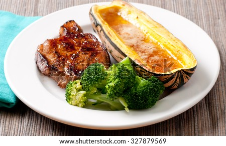 ethicvally raised pork neck chop with delicata squash and vegetable stock photo - stock photo