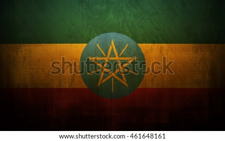 Ethiopia country flag with dark grunge wall texture background.