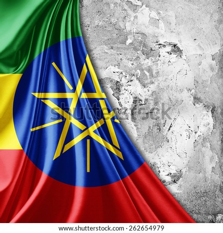 Ethiopia flag and wall background - stock photo