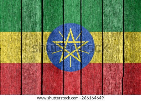 Ethiopia flag on old wood texture background - stock photo