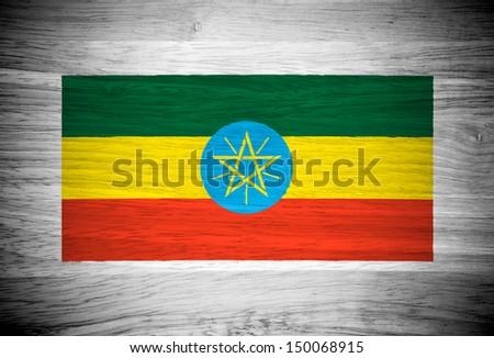 Ethiopia flag on wood texture - stock photo