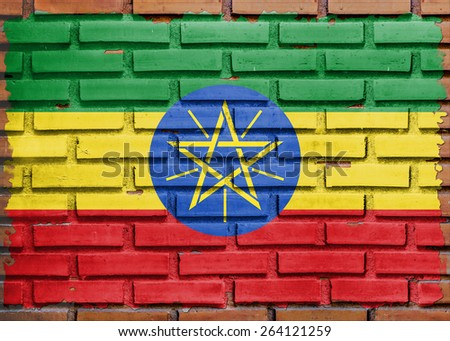 Ethiopia flag painted on  brown brick wall background - stock photo