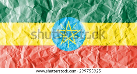 Ethiopia flag painted on crumpled paper background. - stock photo