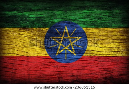 Ethiopia flag pattern on wooden board texture ,retro vintage style - stock photo