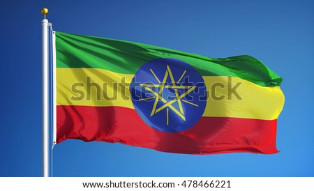 Ethiopian flag waving against clean blue sky, close up, isolated with clipping path mask alpha channel transparency