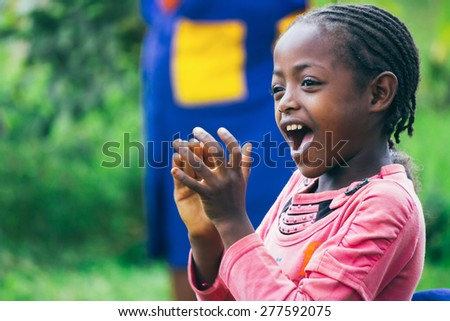 Ethiopian girl singing and clapping during a party - stock photo