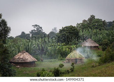 Ethiopian highlands mountain scenery with tribal huts - stock photo