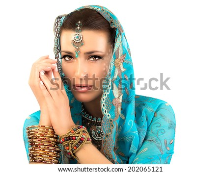 Ethnic beauty. Beautiful hindu woman with traditional clothes, jewelry and makeup - stock photo