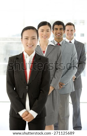 Ethnic business people standing in a row