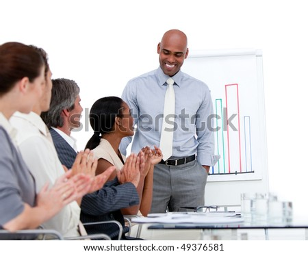 Ethnic businessman presenting statistics in a company against a white background