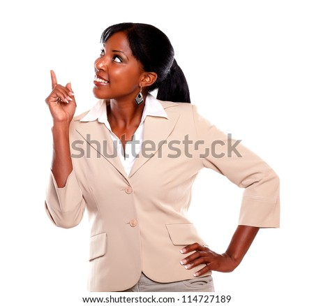 Ethnic businesswoman looking and pointing up on isolated background - stock photo
