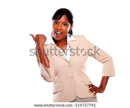 Ethnic businesswoman looking at you and pointing left on isolated background - stock photo