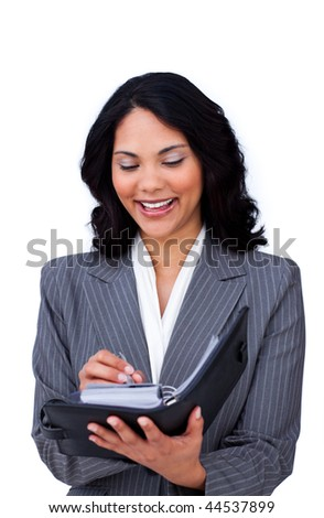 Ethnic businesswoman making notes on her agenda isolated on a white background