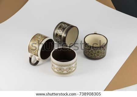 Ethnic colored mugs brown white and black