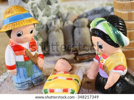 ethnic crib with baby Jesus and the holy family