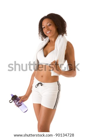 Ethnic female in sporty outfit holding bottle of water (Squinting) - stock photo