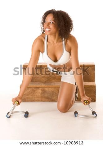 Ethnic female relaxing between pushup exercises - stock photo