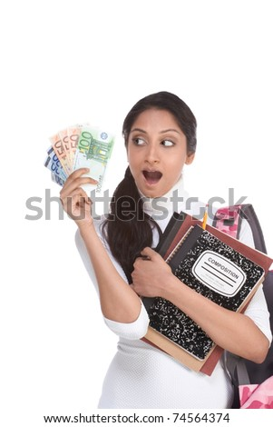 Ethnic Indian college student with compositions notebook and backpack holds pile 100 (one hundred), 50 (fifty) and 20 (twenty) euro bills happy getting money help to subsidies costly university cost - stock photo