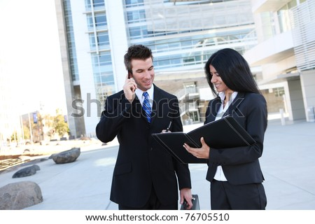 Ethnic man and woman business team at office building - stock photo