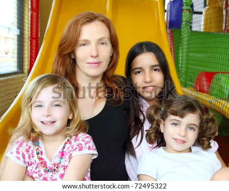 ethnic mixed family mother and daughters indian caucasian latin - stock photo