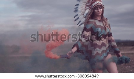 ethnic native american woman with the smoke on the field - stock photo