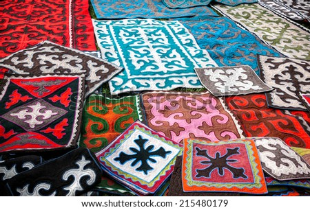 Ethnic oriental carpets with national patterns at Asian market    - stock photo