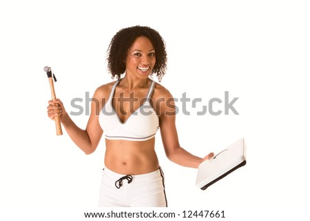 Ethnic woman in sporty outfit hits weight scales by hammer - stock photo