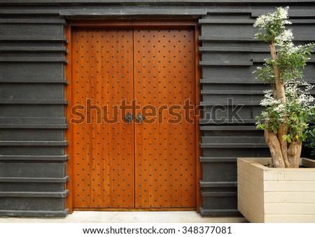 Ethnic wooden studded entrance door - stock photo