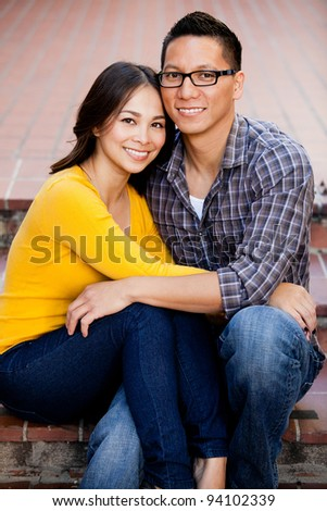 Ethnic young couple smiling and happy - stock photo