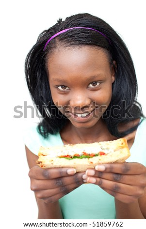 Ethnic young woman eating a sandwich against a white background - stock photo