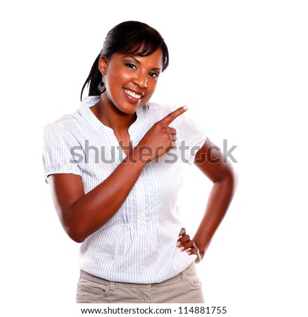 Ethnic young woman pointing right and looking at you against white background - stock photo
